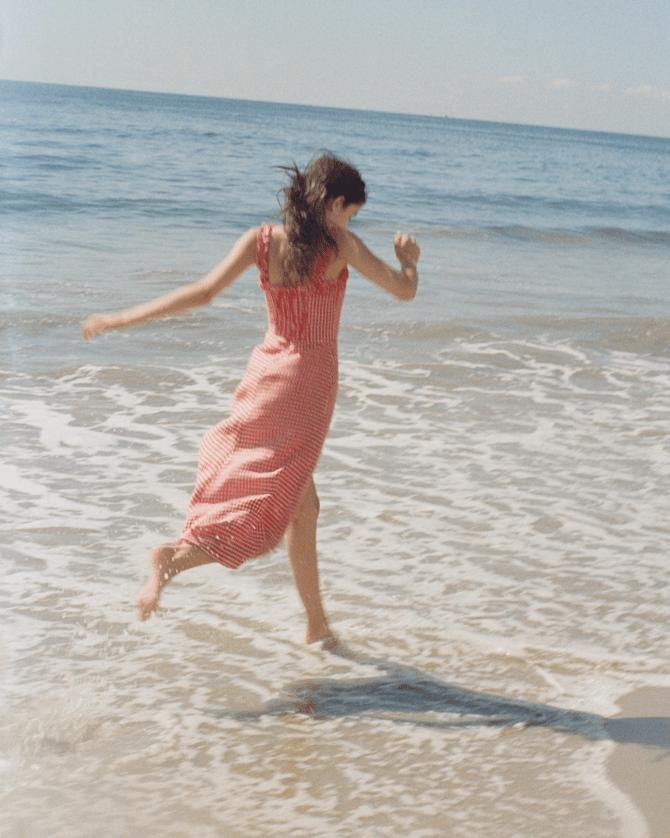 Girl running on the sea coast