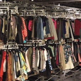 Loading Thredup Warehouse Clothing Racks